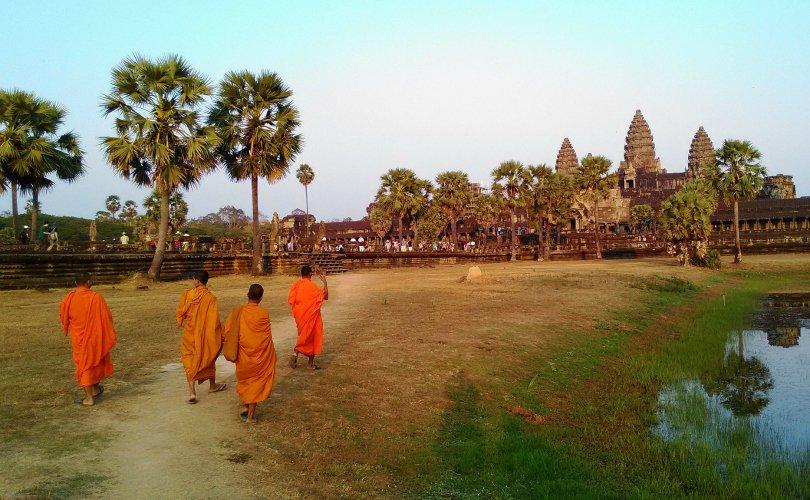 Monks at Angkor Wat - photo by Ken Shirakawa