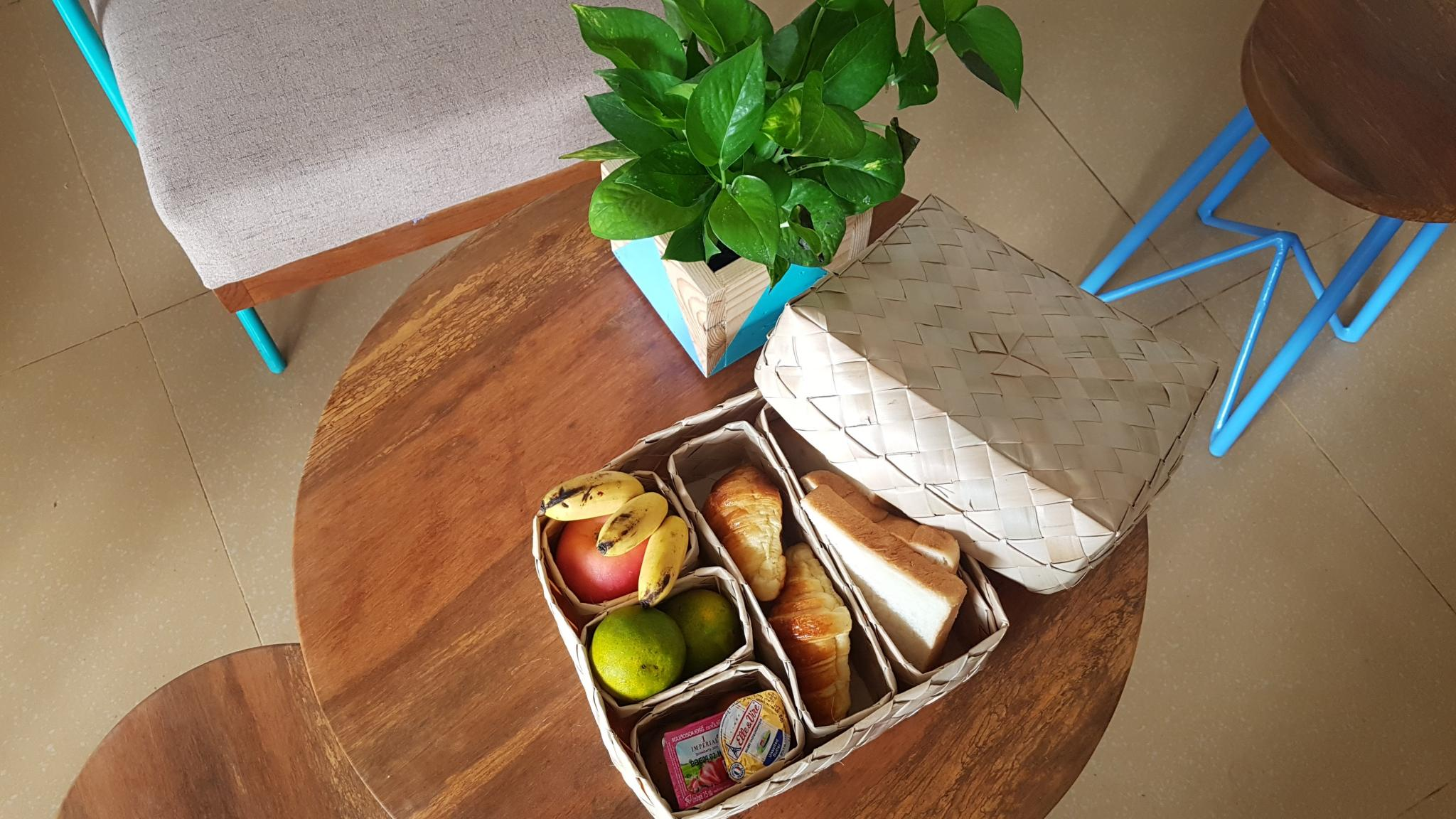 Reusable, locally made handwoven breakfast boxes at Baby Elephant Boutique Hotel as part of our Go Green! sustainability and eco-friendly initiatives in Siem Reap, Cambodia