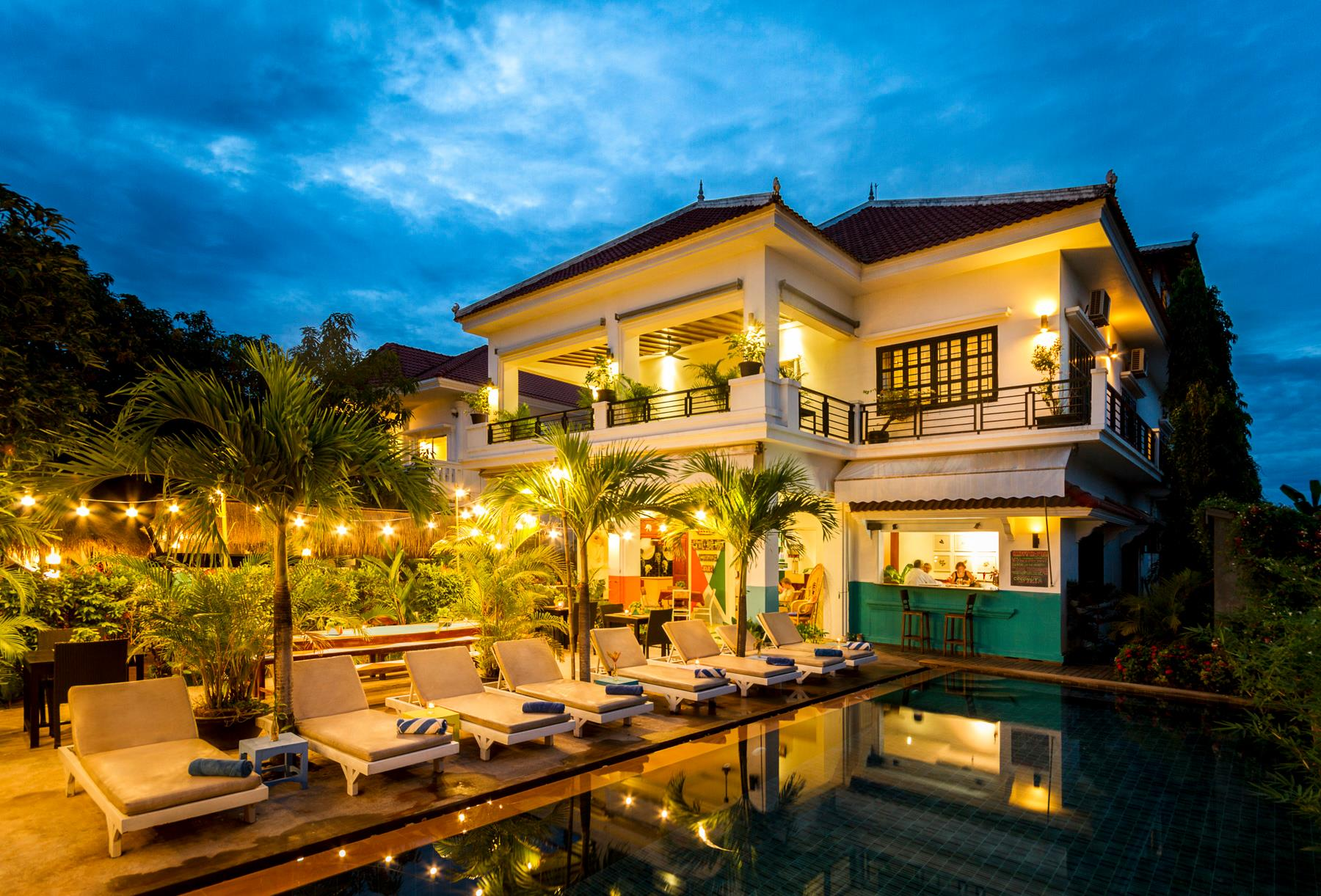 The pool and hotel by night at Baby Elephant Boutique Hotel in Siem Reap, Cambodia