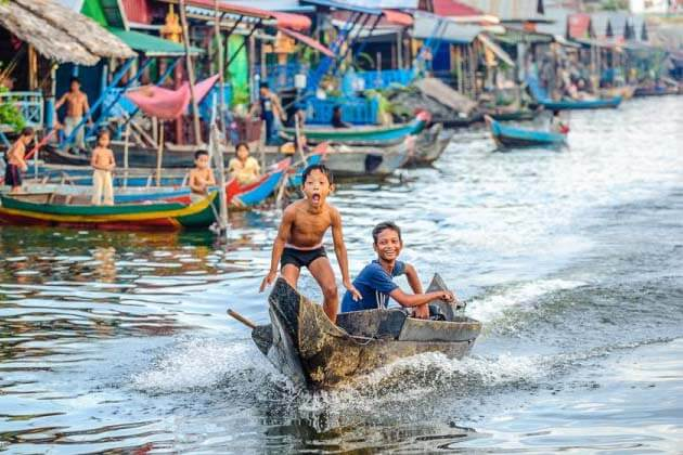 Boys on Boat Tonle Sap Lake in Siem Reap